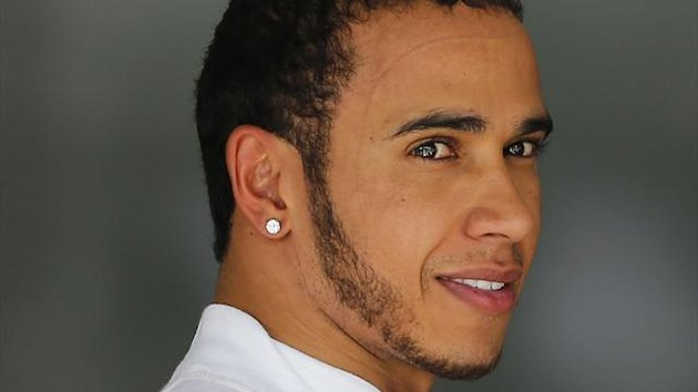 McLaren Formula One driver Lewis Hamilton of Britain is seen at the garage after the second free practice session of the Brazilian F1 Grand Prix at Interlagos circuit in Sao Paulo November 23, 2012.