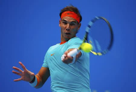 Nadal of Spain returns a shot to Gasquet of France during their men's singles match at the China Open tennis tournament in Beijing