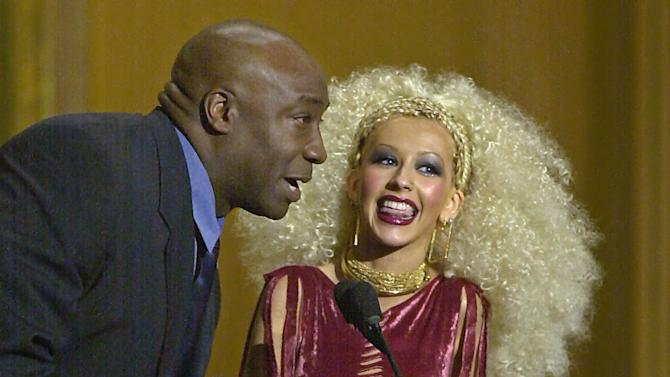 FILE - In this Tuesday, April 10, 2001 file photo, pop singer Christina Aguilera accepts her award for favorite female artist of the year from presenter Michael Clarke Duncan at the Seventh Annual Blockbuster Awards in Los Angeles.  Duncan has died at the age of 54 on Monday, Sept. 3, 2012 in a Los Angeles hospital after nearly two months of treatment following a July 13, 2012 heart attack, his fiancee, the Rev. Omarosa Manigault, said. (AP Photo/Michael Caulfield)