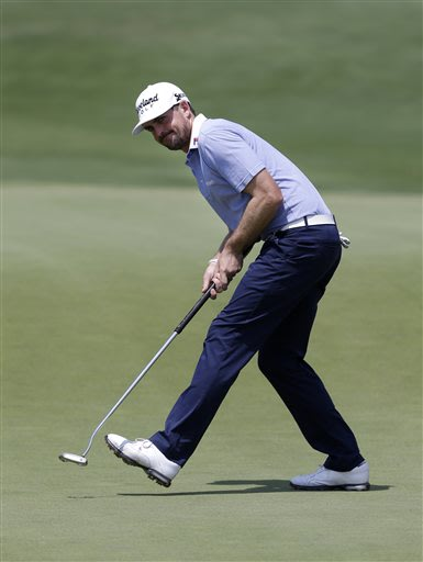 Keegan Bradley takes a long stride as he celebrates his birdie putt on the 11th green during the third round of the Byron Nelson Championship golf tournament Saturday, May 18, 2013, in Irving, Texas