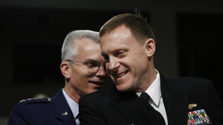 U.S. Navy Vice Admiral Rogers and U.S. Air Force General Selva chat before giving testimonies at Senate Armed Services Committee confirmation hearing on Capitol Hill in Washington