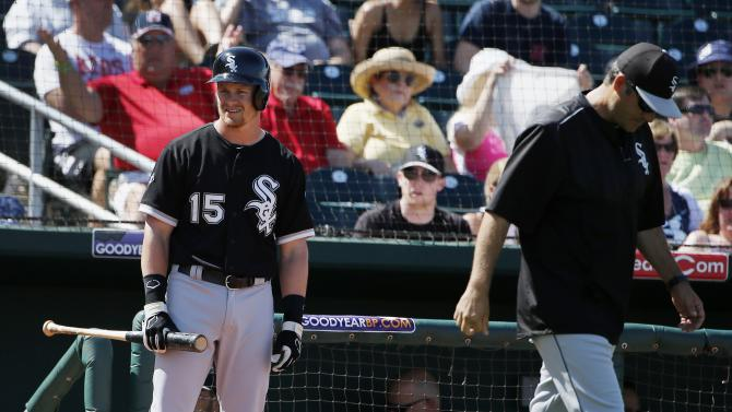 Chicago White Sox's Gordon Beckham (15) stares at home plate umpire Chad Whitson as manager Robin Ventura, right, goes out to argue an interference call on Beckham while batting during the fifth inning of a spring training baseball game against the Cleveland Indians Sunday, March 29, 2015, in Goodyear, Ariz.  The White Sox defeated the Indians 4-1. (AP Photo/Ross D. Franklin)