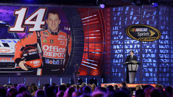 Tony Stewart speaks during the season-ending NASCAR awards ceremony while accepting the award for his ninth-place finish in the NASCAR Sprint Cup title race, Friday, Nov. 30, 2012 in Las Vegas. (AP Photo/Julie Jacobson)