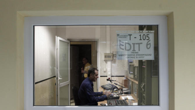 An employee works at Greek state television ERT headquarters in Athens, on Tuesday, June 11, 2013. Greece is to close down all its state-run TV and radio stations with the loss of some 2,500 jobs as part of its cost-cutting drive demanded by the bailed-out country's international creditors. (AP Photo/Petros Giannakouris)