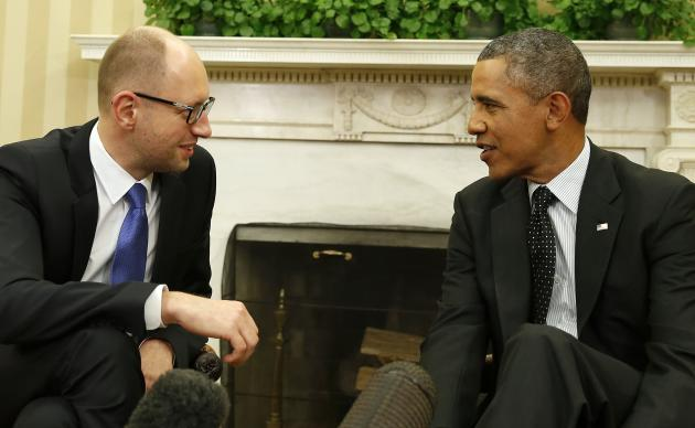 U.S. President Barack Obama listens to Ukraine Prime Minister Arseniy Yatsenyuk in the Oval Office of the White House in Washington