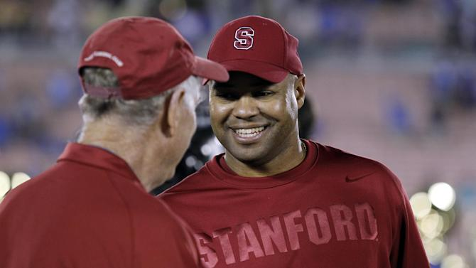 Stanford head coach David Shaw, right, shakes hands with honorary captain Jack Lasater after defeating UCLA 35-17 during their NCAA college football game, Saturday, Nov. 24, 2012, in Pasadena, Calif. (AP Photo/Alex Gallardo)