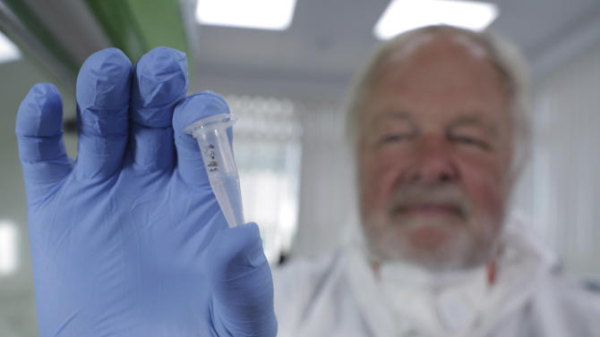 genetics professor Bryan Sykes posing with a prepared DNA sample taken from hair from a Himalayan animal.