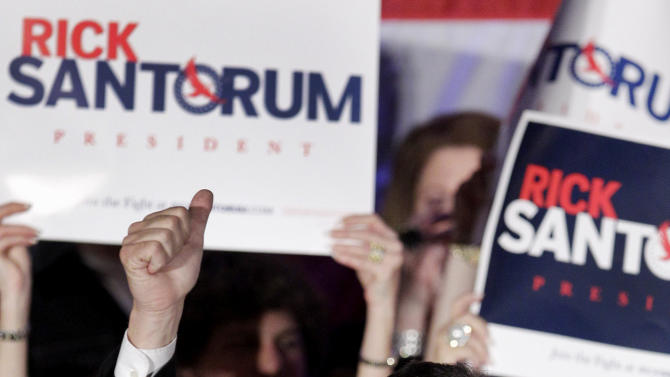 Republican presidential candidate, former Pennsylvania Sen. Rick Santorum greets supporters at an election night party in Cranberry Township, Pa., Tuesday, April 3, 2012.  (AP Photo/Gene J. Puskar)