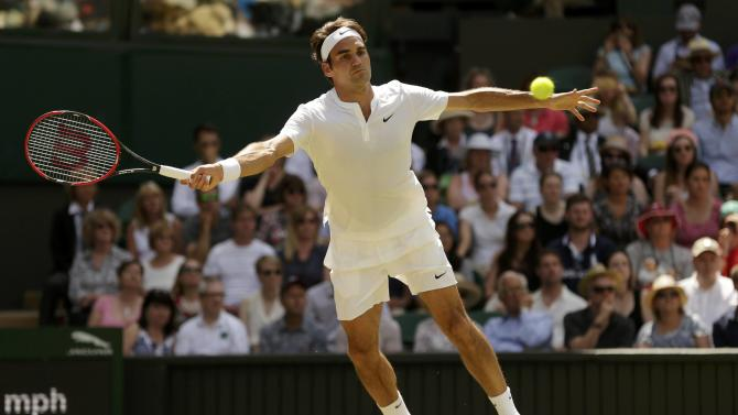 Roger Federer of Switzerland hits a shot during his match against Samuel Groth of Australia at the Wimbledon Tennis Championships in London