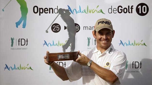 Louis Oosthuizen of South Africa poses with his trophy after winning the Andalucia Open golf tournament in Malaga in 2010 (Reuters)
