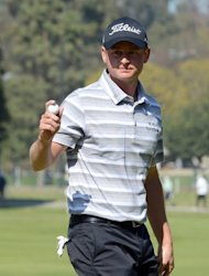 John Merrick celebrates his birdie on the 10th hole during the final round of the Northern Trust Open at the Riviera Country Club on February 17, 2013. Merrick was one of three players who started the day three shots off the lead held by Bill Haas and he had four birdies and two bogeys in a final-round 69 for 11-under 273