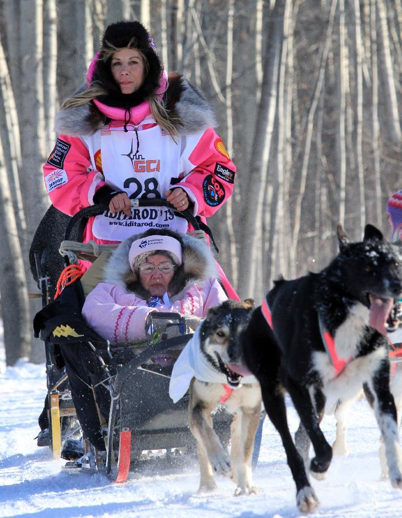 DeeDee Jonrowe drives her team during the ceremonial start of the Iditarod Trail Sled Dog Race Saturday, March 2, 2013, in Anchorage, Alaska. The competitive portion of the 1,000-mile race is scheduled to begin Sunday in Willow, Alaska. (AP Photo/Dan Joling)