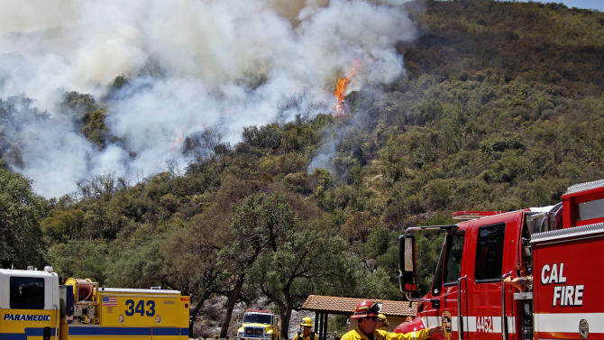 Firefighting crews approach a fire in the Los Padres National Forest near Santa Barbara, Calif. on Tuesday, May 28, 2013. Firefighters took advantage of a lull in winds on Tuesday to try to gain ground against a forest fire in mountains north of Santa Barbara, as crews elsewhere in Southern California chased a new fire north of Los Angeles and sought to increase containment of a rural San Diego County blaze. (AP Photo/Nick Ut)