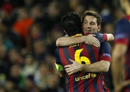 Barcelona's Messi is congratulated by his teammate Xavi after scoring a goal against Manchester City during their Champions League last 16 second leg soccer match