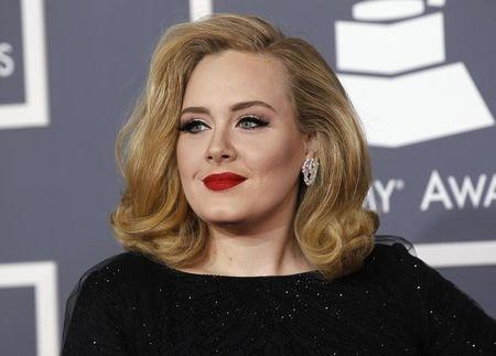 British singer Adele arrives at the 54th annual Grammy Awards in Los Angeles