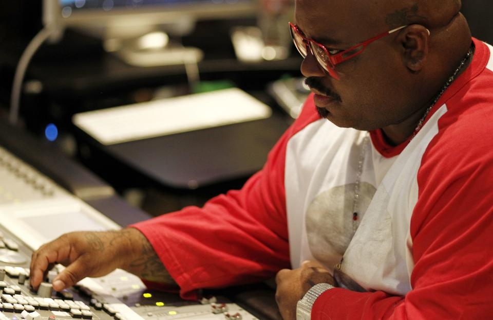 "In this May 2, 2012 photo, musician Cee-Lo Green is shown in a music studio in Los Angeles. Green, a judge on the singing competition series ""The Voice,"" says he'll stick with the show ""as long as it's fresh."" The rapper turned singer joined the show last year as coach and judge alongside Christina Aguilera, Blake Shelton and Adam Levine. (AP Photo/Matt Sayles)"