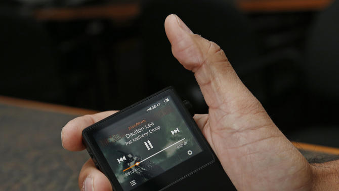 In this Monday, Dec. 17, 2012 photo, the Astell & Kern AK100, is displayed for a photographer in Atlanta. The Astell & Kern AK100 is a portable music player retailing for $699 and is capable of playing 24-bit, audiophile-quality digital music files. (AP Photo/John Bazemore)
