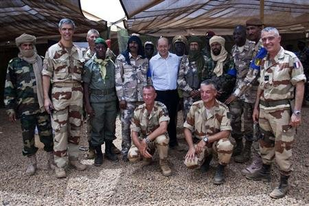 French Defence Minister Jean-Yves Le Drian (C) poses for a picture with French and Malian army officers at the French military base at the airport in Gao, April 26, 2013. REUTERS/Francois Rihouay