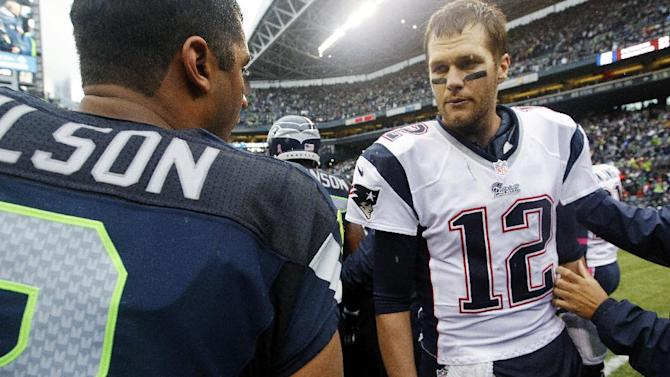 New England Patriots quarterback Tom Brady (12) talks with Seattle Seahawks quarterback Russell Wilson after an NFL football game, Sunday, Oct. 14, 2012, in Seattle. The Seahawks won 24-23. (AP Photo/Elaine Thompson)