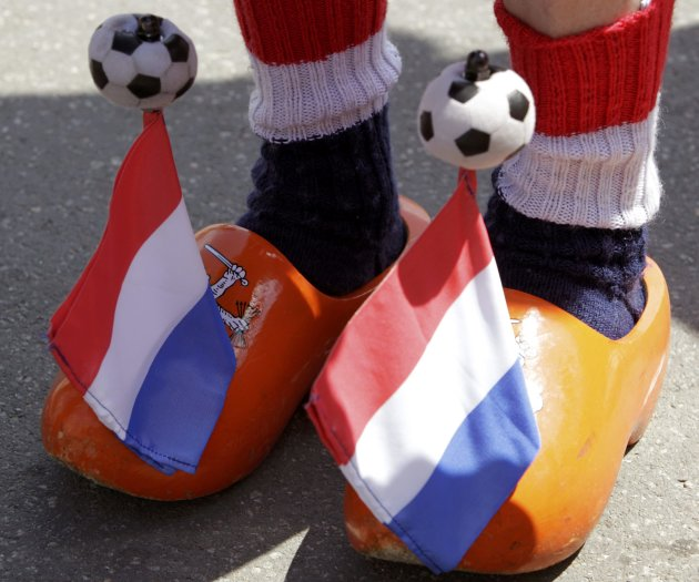 Netherlands soccer fan wears wooden clogs at Euro 2012 fan zone in Kharkiv