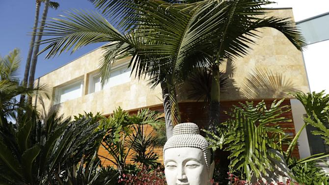 A stone figure sits in front of the home owned by the family of Mexican union leader Elba Esther Gordillo in Coronado, California, Wednesday, Feb. 27, 2013. Gordillo was arrested and accused Tuesday in Mexico of embezzling $160 million in union funds to pay for everything from California homes and plastic surgery procedures to her Neiman Marcus bill. Gordillo, known for flashing her Hermes handbags and heels, stood behind bars Wednesday in a grim prison in eastern Mexico City as a judge read off charges of embezzlement and organized crime.  (AP Photo/Gregory Bull)