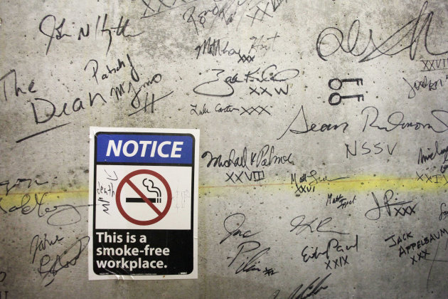 In this Jan. 15, 2013 photo, autographs cover a wall on a top floor of One World Trade Center in New York. Construction workers finishing New York's tallest building at the World Trade Center are leav