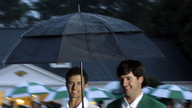 Adam Scott, of Australia, walks with Bubba Watson for the green jacket presentation after winning the Masters golf tournament Sunday, April 14, 2013, in Augusta, Ga. (AP Photo/Charlie Riedel)