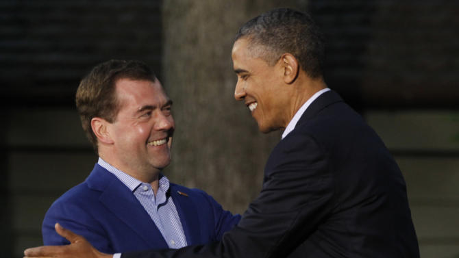 President Barack Obama, right, shakes hands with Russia's Prime Minister Dmitry Medvedev on arrival for the G8 Summit Friday, May 18, 2012 at Camp David, Md. (AP Photo/Charles Dharapak)