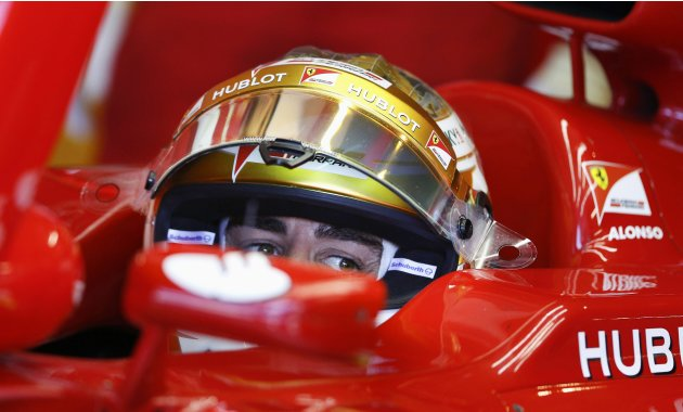 Ferrari Formula One driver Fernando Alonso of Spain looks on in his car during the second practice session of the Monaco F1 Grand Prix