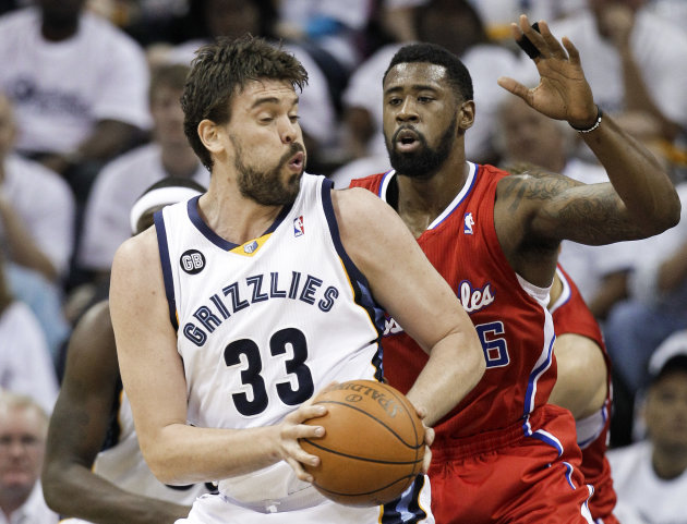 Memphis Grizzlies center Marc Gasol (33), of Spain, tries to get past Los Angeles Clippers center DeAndre Jordan (6) in the first half of Game 5 of a first-round NBA basketball playoff series, Wednesd