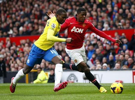 Manchester United's Zaha challenges Newcastle United's Yanga-Mbiwa during their English Premier League soccer match at Old Trafford in Manchester