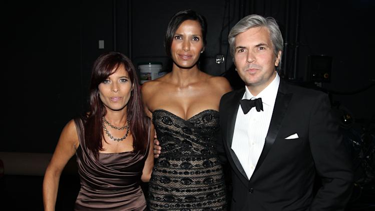 Jane Lipsitz, left, Padma Lakshmi, center, and Dan Cutforth pose backstage at the 2012 Creative Arts Emmys at the Nokia Theatre on Saturday, Sept. 15, 2012, in Los Angeles. (Photo by Matt Sayles/Invision/AP)