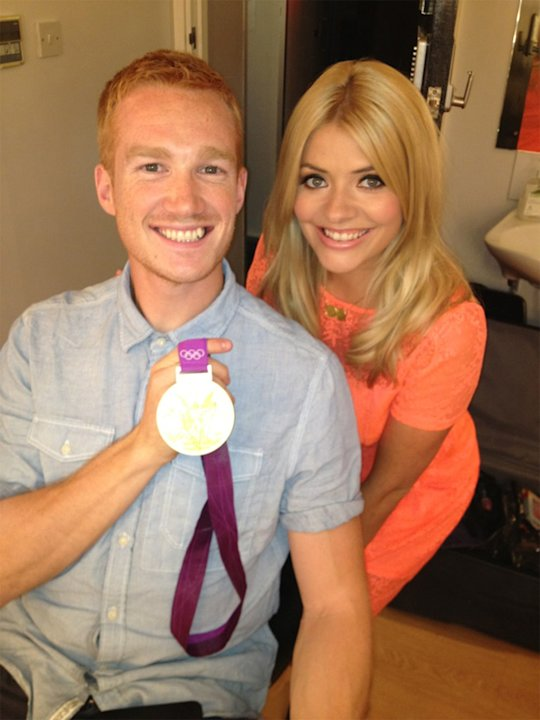 Celebrity photos: After he appeared on This Morning, Holly Willoughby couldn't wait to get a snap with Greg Rutherford and his gold medal. We don't blame her.