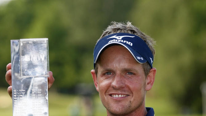 England's Luke Donald poses with the trophy after winning the PGA Championship at the Wentworth golf club, Virginia Water, England, Sunday May 27, 2012. (AP Photo/Tim Hales)