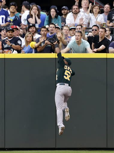 Solo HRs propel A's to 4-3 win against Mariners