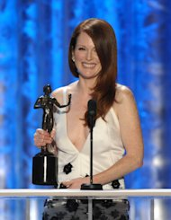 Julianne Moore accepts the award for outstanding female actor in a TV movie or miniseries for Game Change at the 19th Annual Screen Actors Guild Awards at the Shrine Auditorium in Los Angeles on Sunday, Jan. 27, 2013. (Photo by John Shearer/Invision/AP)
