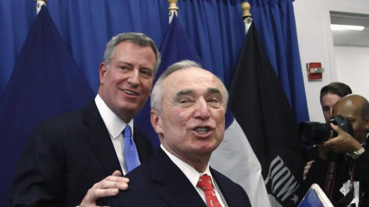 Blasio and Bratton exit the room after a news conference in Brooklyn