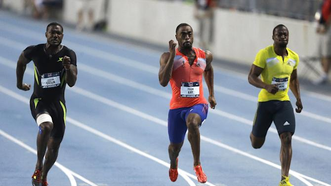Tyson Gay, center, leads Justin Gatllin, left, and Charles Silmon, right, during the senior men's 100-meter dash final at the U.S. Championships athletics meet, Friday, June 21, 2013, in Des Moines, Iowa. Gay won the race in 9.75 seconds. (AP Photo/Charlie Neibergall)