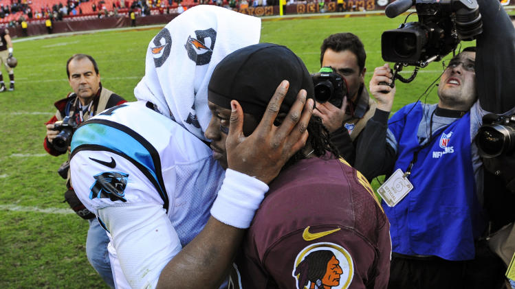 Carolina Panthers quarterback Cam Newton, left, greets Washington Redskins quarterback Robert Griffin III after an NFL football game, Sunday, Nov. 4, 2012, in Landover, Md. The Panthers won 21-13. (AP Photo/Richard Lipski)