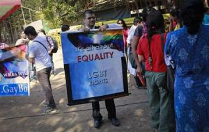 A gay rights activist folds a banner at a protest organised against the Supreme Court's order on gay sex in Mumbai