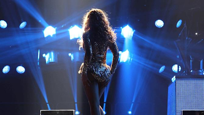 """Singer Beyonce performs on the opening night of her """"Mrs. Carter Show World Tour 2013"""", on Monday, April 15, 2013 at the Kombank Arena in Belgrade, Serbia. Beyonce is wearing a custom gold, flesh-toned one-piece by designers The Blonds.(Photo by Yosra El-Essawy/Invision for Parkwood Entertainment/AP Images)"""