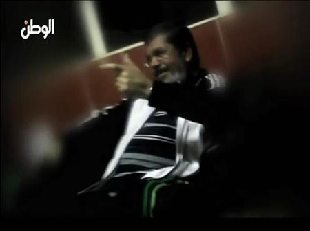 A still from video released by Al Watan newspaper shows what it says is ousted ex-Egyptian leader Mursi speaking to unidentified individuals whilst in prison