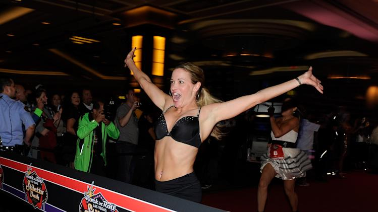 LAS VEGAS, NV - DECEMBER 03: Suzy Favor Hamilton attends the Rock 'n' Roll Las Vegas Stiletto Dash at The Palazzo on December 3, 2011 in Las Vegas, Nevada. (Photo by David Becker/WireImage)
