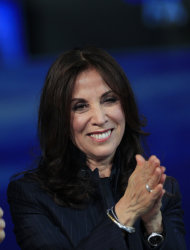 FILE - In this April 14, 2012 file photo, Olivia Harrison, the widow of George Harrison, former member of The Beatles attends the Italian State RAI TV program &quot;Che Tempo che Fa&quot;, in Milan, Italy. George Harrison&#39;s widow Olivia hopes to add a more personal side to the reticent Beatle with her new multi-touch book. Based on the documentary, George Harrison: Living in the Material World, the book is available Tuesday, May 1, on the iTunes bookstore. It includes audio, video material from the film along with personal photographs, letters, and memorabilia never seen by the public. (AP Photo/Luca Bruno, file)