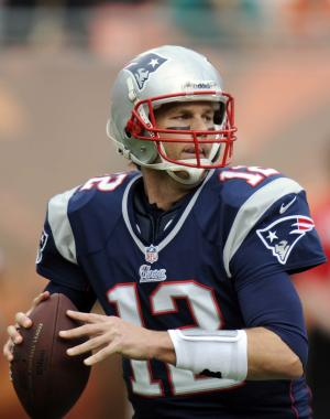 New England Patriots quarterback Tom Brady (12) looks to pass during the first half of an NFL football game against the Miami Dolphins, Sunday, Dec. 2, 2012, in Miami. (AP Photo/Rhona Wise)