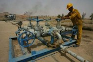 A worker checks valves at the Bai Hassan oil field. Five bombs exploded at a northern Iraqi oil field on Saturday morning, damaging two pipelines without affecting the country's vital crude exports, officials said