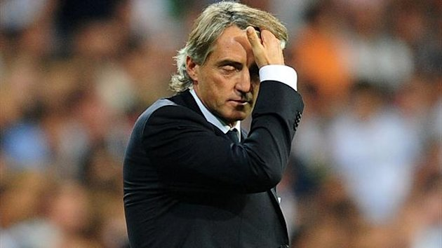 Manchester City&#39;s Manager Roberto Mancini stands dejected towards the end of the game UEFA Champions League - Group D - Real Madrid v Manchester City - Santiago Bernabeu