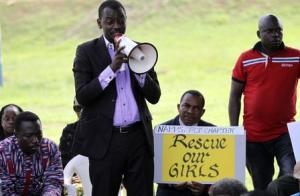 Protester addresses a sit-in rally in support of the release of the abducted Chibok schoolgirls, at the Unity Fountain in Abuja
