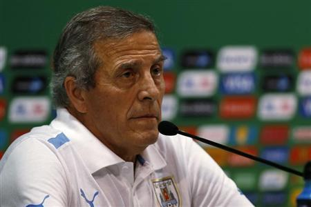Uruguay's soccer team head coach Oscar Tabarez listens to a question during a news conference after a training session in Recife