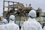 "Japanese investigators visit the stricken Fukushima nuclear power plant in June 2011. The Fukushima nuclear accident was a man-made disaster caused by Japan's culture of ""reflexive obedience"" and not just the tsunami that hit the plant, according to a damning parliamentary report"
